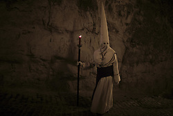 April 14, 2017 - Zamora, Spain - Penitents from the Hermandad Penitencial de Jesus Yacente brotherhood take part in a procession in the early hours of Friday. Hundreds of processions took place throughout Spain during the Easter Holy Week. (Credit Image: © Manuel Balles via ZUMA Wire)