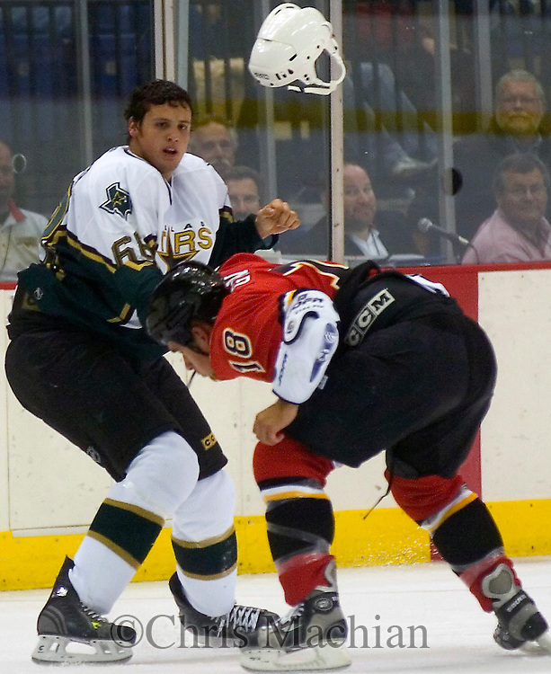 9/29/05  Omaha, NE Omaha Knight's Carsen Germyn ducks a punch from the Stars' Francis Wathier at the Omaha Civic Auditorium Thursday night,(photo by Chris Machian/Prarie Pixel Group)