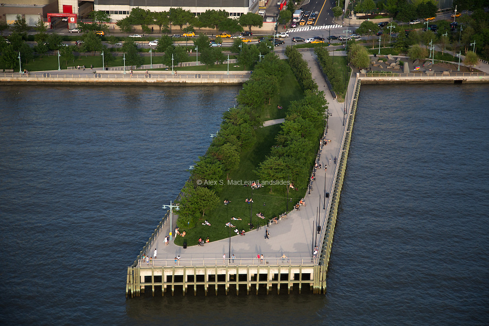 A pier with green space and trees at Hudson River Park, designed by Michael Van Valkenburgh Associates