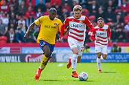 Kieran Sadlier of Doncaster Rovers (22) and Anfernee Dijksteel of Charlton Athletic (2) in action during the EFL Sky Bet League 1 play off first leg match between Doncaster Rovers and Charlton Athletic at the Keepmoat Stadium, Doncaster, England on 12 May 2019.