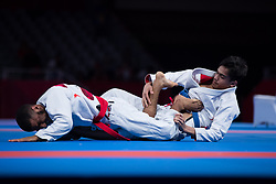 JAKARTA, Aug. 24, 2018  Hamad Nawad (L) of the UAE competes against Khalid ALblooshi of the UAE during the Ju-Jitsu Newaza Men's -56 kg Final - Gold Medal competition of the 18th Asian Games in Jakarta, Indonesia, Aug. 24, 2018. Hamad Nawad won the match and got the gold medal. (Credit Image: © Zhu Wei/Xinhua via ZUMA Wire)