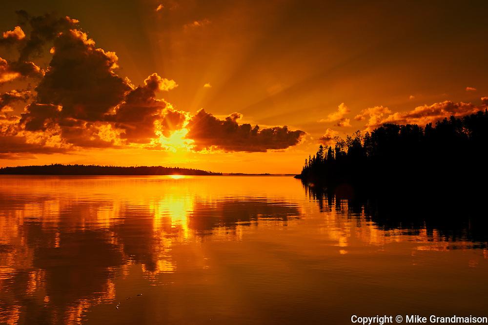 Sunrise reflection on Lac Seul<br /> Ear Falls<br /> Ontario<br /> Canada