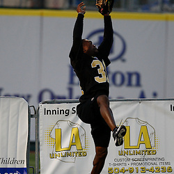 Apr 28, 2010; Metairie, LA, USA; Pierson Prioleau (31) makes a catch at the wall during the Heath Evans Foundation charity softball game featuring teammates of the Super Bowl XLIV Champion New Orleans Saints at Zephyrs Field.  Mandatory Credit: Derick E. Hingle-US-PRESSWIRE.