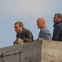 US actor Bruce Willis (C) with costars Jai Courtney (L) of Australia and Sebastian Koch (R) of Germany are seen during a shooting of the fifth piece in the Die Hard series titled Good Day to Die Hard during a shooting day in Budapest, Hungary on May 19, 2012. ATTILA VOLGYI