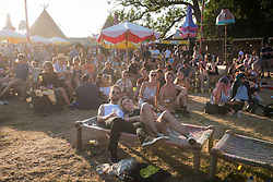 Festival goers relax in the VIP Castle stage area during Bestival 2018 at Lulworth Castle - Wareham. Picture date: Saturday 4th August 2018. Photo credit should read: David Jensen/EMPICS Entertainment