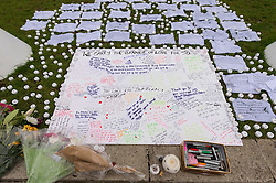 © Licensed to London News Pictures. 17/06/2016. Tributes in Parliament Square in memory of Labour party MP Jo Cox.  She was allegedly attacked and killed by suspect 52 year old Tommy Mair close to Birstall Library near Leeds.  London, UK. Photo credit: Ray Tang/LNP