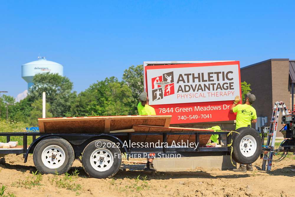 Monument sign installation in progress at site of new physical therapy and wellness center.