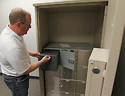 Bank of Belleville Executive Vice-President Ron Stephens shows a safety deposit box inside one of the massive Porta-Vaults. Multiple layers of high-tech security guard the bank and the contents of the boxes, with backup systems in place as well.