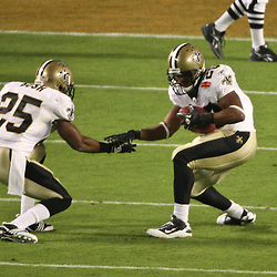 2010 February 07: New Orleans Saints running back Pierre Thomas (23) celebrates a touchdown with running back Reggie Bush (25) during a 31-17 win by the New Orleans Saints over the Indianapolis Colts in Super Bowl XLIV at Sun Life Stadium in Miami, Florida.