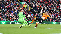 Football - 2016 / 2017 FA Cup - Fourth Round: Liverpool vs. Wolverhampton Wanderers<br /> <br /> Loris Karius of Liverpool saves from Jon Dadi Bodvarsson of Wolverhampton Wanderers during the match at Anfield.<br /> <br /> COLORSPORT/LYNNE CAMERON