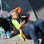 A small group of Actvists continue sit-in some chianed in pair after the pink boat removed by police in Oxford Street, London, UK. 20 April 2019