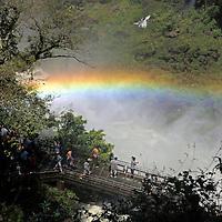 South America, Argentina, Iguacu Falls. Visitors see rainbow at Iguacu Falls.