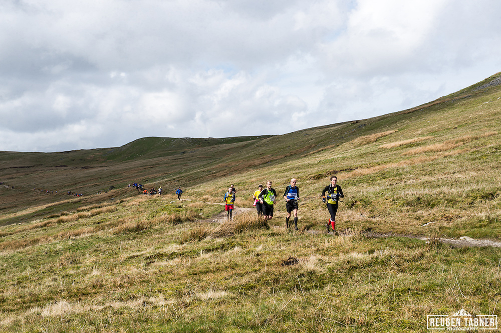 Runners make their way down off Ingleborough in the Yorkshire Dales during the 60th Yorkshire Three Peaks Race.