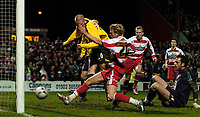 Photo: Jed Wee.<br /> Doncaster Rovers v Arsenal. Carling Cup. 21/12/2005.<br /> <br /> Doncaster's Paul Green (C) profits from confusion between Arsenal defender Phillip Senderos and goalkeeper Manuel Almunia to prod home the first goal of extra time.