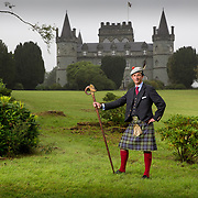 Torquil Campbell the Duke of Argyll of the Campbell Clan in the grounds of Inveraray Castle. The stick has a wild boar's head carved into it; this is the emblem of the Clan Campbell.<br /> <br /> Picture Robert Perry for Country Life 14th August 2018