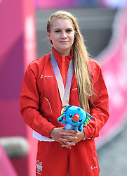 England's Evie Richards with her silver medal after the Women's Cross-country at the Nerang Mountain Bike Trails during day eight of the 2018 Commonwealth Games in the Gold Coast, Australia.