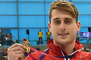 Christoph Walker-Hebborn poses with his team gold medal in the 4 x 100m Medley during day 14 of the 33rd  LEN European Aquatics Championship Swimming Finals 2016 at the London Aquatics Centre, London, United Kingdom on 22nd May 2016. Photo by Martin Cole.