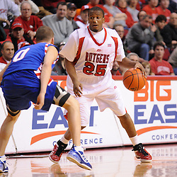 Jan 31, 2009; Piscataway, NJ, USA; Rutgers guard Corey Chandler (25), after returning from a bloodied nose and wearing a new jersey makes a move against DePaul guard Michael Bizoukas (0) during the second half of Rutgers' 75-56 victory over DePaul in NCAA college basketball at the Louis Brown Athletic Center