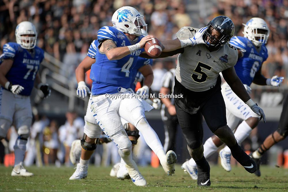 Memphis quarterback Riley Ferguson (4) eludes Central Florida defensive lineman Jamiyus Pittman (5) during the second half of the American Athletic Conference championship NCAA college football game Saturday, Dec. 2, 2017, in Orlando, Fla. Central Florida won 62-55. (Photo by Phelan M. Ebenhack)