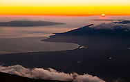 From the highest point in Maui, Hawai'i one can see the much lower west Maui mountains and the island of Lana'i along with spectacular sunsets. This image was taken from the summit, Puu'u'ula'ula, of the inactive volcano Haleakala inside its namesake National Park at 10,023 feet.