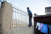 A young boy from Syria looks out over the Bekaa Valley from a school which has been turned into a refugee camp for Syrians. The ongoing war in Syria has caused hundreds of thousands of Syrian to come to Lebanon.