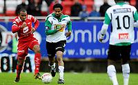 Fotball<br /> 2. Oktober 2010<br /> Eliteserien<br /> Brann Stadion<br /> Brann - Hønefoss 3 - 2<br /> Rodolph Austin (L) , Brann<br /> Paul Obiefule (M) og Umaru Bangura (R) , Hønefoss<br /> Foto : Astrid M. Nordhaug