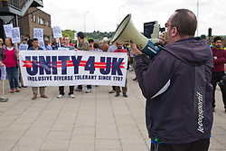 Luton, UK. 27th June, 2015. Paul Sillett of Unite Against Fascism addresses local residents and anti-racist activists at a counter-protest against a march by far-right group Britain First. A large police presence kept the two groups apart.