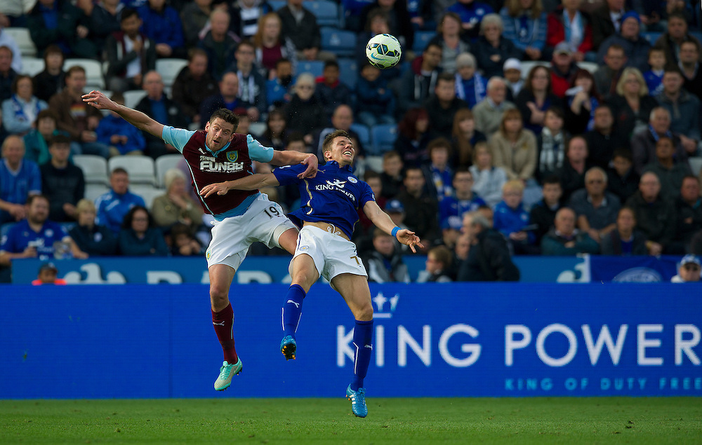 Burnley's Lukas Jutkiewicz and Leicester City's Dean Hammond<br /> <br /> Photographer Stephen White/CameraSport<br /> <br /> Football - Barclays Premiership - Leicester City v Burnley - Saturday 04th October 2014 - King Power Stadium - Leicester<br /> <br /> © CameraSport - 43 Linden Ave. Countesthorpe. Leicester. England. LE8 5PG - Tel: +44 (0) 116 277 4147 - admin@camerasport.com - www.camerasport.com