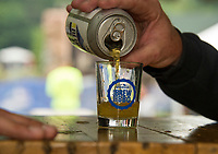 Arthur Chase pours a Lemon Blueberry American Pale Ale from the Woodstock Inn Brewery during the Gunstock Mountain Brew and BBQ Fest Saturday afternoon.  (Karen Bobotas/for the Laconia Daily Sun)