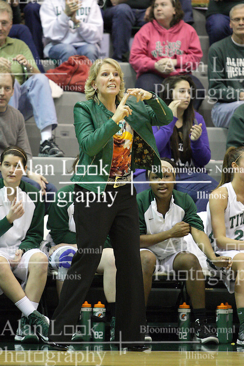 16 February 2013:  Mia Smith asks for a time out during an NCAA women's division 3 basketball game between the Millikin Big Blue and the Illinois Wesleyan Titans in Shirk Center, Bloomington IL