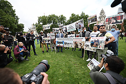 © Licensed to London News Pictures. 18/08/2021. London, UK. A group of former Afghan interpreters stage a protest outside the Houses of Parliament. . Both houses fo Parliament have been recalled to discuss the ongoing situation in Afghanistan, where the Taliban have advanced quickly through the country after U. S troops started a full withdrawal . Photo credit: Ben Cawthra/LNP