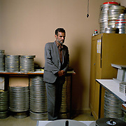 "Ahmad Sidiqqi, photographed in the laboratory that he runs,  has worked at Afghan Film for many years. ""During the Mujahideen years the building was attacked. I was here when it was shelled, The archives were saved from the Taliban who wanted to burn them. They were hidden in a secret room""<br /> <br /> His boss is Engineer Latif Ahmadi, who explains how, even with the allied occupation of Kabul, filming is still difficult:<br /> <br /> ""We were filming a hundred yards from a suicide bombing, one hundred metres from the Ministry of Culture, five people were killed. We actually felt the force of the explosion and heard the shots. It took two minutes for the dust to clear but I told the director, 'please continue', because what can we do but carry on?"""