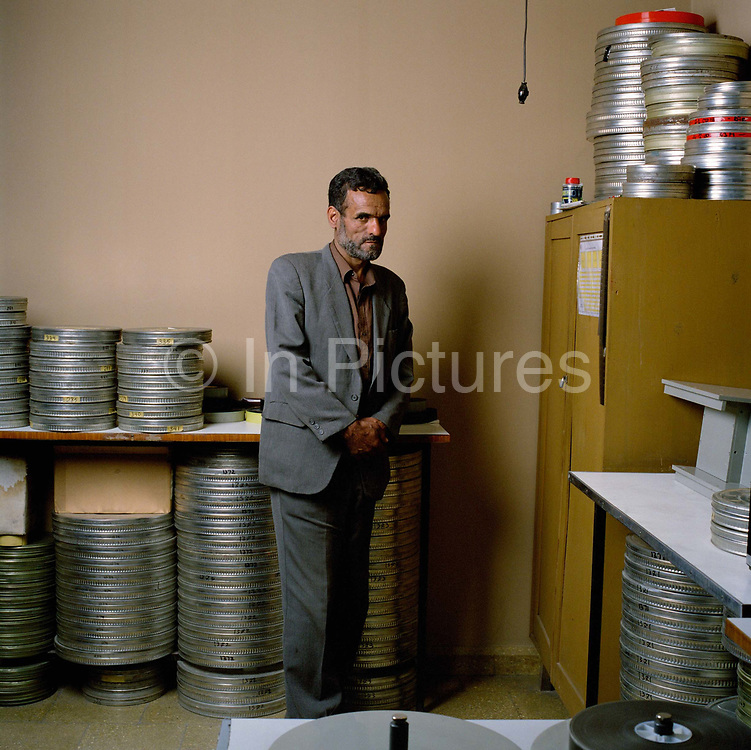 """Ahmad Sidiqqi, photographed in the laboratory that he runs,  has worked at Afghan Film for many years. """"During the Mujahideen years the building was attacked. I was here when it was shelled, The archives were saved from the Taliban who wanted to burn them. They were hidden in a secret room""""<br /> <br /> His boss is Engineer Latif Ahmadi, who explains how, even with the allied occupation of Kabul, filming is still difficult:<br /> <br /> """"We were filming a hundred yards from a suicide bombing, one hundred metres from the Ministry of Culture, five people were killed. We actually felt the force of the explosion and heard the shots. It took two minutes for the dust to clear but I told the director, 'please continue', because what can we do but carry on?"""""""