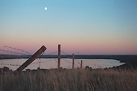 Barbed Wire Fence overlooking Katepwa Lake, Qu'Appelle Valley Saskatchewan Canada