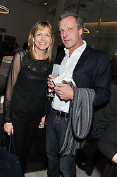 CAROL WOOLTON and HUGO BURNAND at a party to celebrate the publication of Fame Game by Louise Fennell held at Grace, West Halkin Street, London on 12th March 2013.