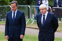 Hyde Park, London, July7th 2015. The Mayor of London Boris Johnson and other senior political figures, the Commissioners for transport and policing in the capital, as well as senior representatives of the emergency services  lay wreaths at the 7/7 memorial in Hyde Park. PICTURED: Prime Minister David Cameron and Boris Johnson in reflective mood.