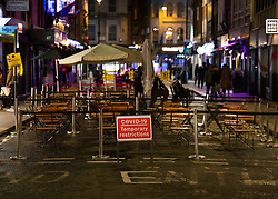 © Licensed to London News Pictures. 23/09/2020. London, UK. Soho in central London remained mostly quiet on the last night before the 10PM curfew comes into force. Prime Minister Boris Johnson has announced new measures to attempt to reduce the rising number of new Covid-19 infections. Photo credit: Peter Macdiarmid/LNP