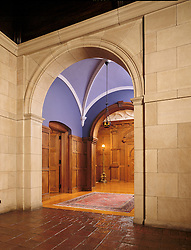 Classic interior stone archway with doors and vaulted ceiling