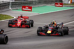 May 13, 2018 - Barcelona, Catalonia, Spain - 05 Sebastian Vettel from Germany with Scuderia Ferrari SF71H trying to overtake 33 Max Verstappen Max from Netherlands Aston Martin Red Bull Tag Heuer RB14 during the Spanish Formula One Grand Prix at Circuit de Catalunya on May 13, 2018 in Montmelo, Spain. (Credit Image: © Xavier Bonilla/NurPhoto via ZUMA Press)