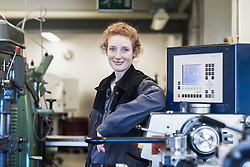 Portrait of a young female engineer standing in an industrial plant, Freiburg im Breisgau, Baden-W¸rttemberg, Germany