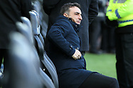 Swansea city manager Carlos Carvalhal looks on from his seat in the dugout ahead of k/o.The Emirates FA Cup, quarter-final match, Swansea city v Tottenham Hotspur at the Liberty Stadium in Swansea, South Wales on Saturday 17th March 2018.<br /> pic by  Andrew Orchard, Andrew Orchard sports photography.