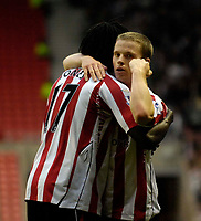 Photo: Jed Wee/Sportsbeat Images.<br /> Sunderland v Fulham. The FA Barclays Premiership. 27/10/2007.<br /> <br /> Sunderland's Grant Leadbitter (R) celebrates with goalscorer Kenwyne Jones.