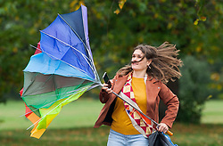 ©Licensed to London News Pictures 29/10/2020  <br /> Greenwich, UK. A lady fighting with the wind for her umbrella in Greenwich Park, London. October is set to be the wettest month in years as an Atlantic storm brings wet and windy weather to parts of the UK today. Photo credit:Grant Falvey/LNP