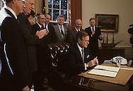 President H. W Bush signs the minimum wage bill during the administration of H.W. Bush (Bush 41)..Photograph by Dennis Brack, BB 29