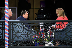 ©  London News Pictures. 21/04/2016. Windsor, UK. LORD SEBASTIAN COE (left) talking on a television programme ahead of a walkabout by Queen Elizabeth II through the town of Windsor, Berkshire on the day of her 90th birthday.  Photo credit: Ben Cawthra/LNP