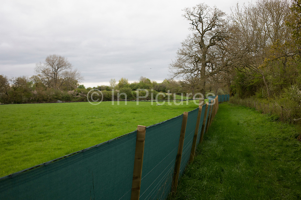 Fenced of area in the countryside in preparation for the beginning of construction of the HS2 high speed rail link in Ufton, England, United Kingdom. High Speed 2 is a planned high-speed railway which is aimed to be the new backbone of the national rail network, linking the south with the Midlands and furthe north. It is a highly topical and political issue due to the environmental impact for those along the route.