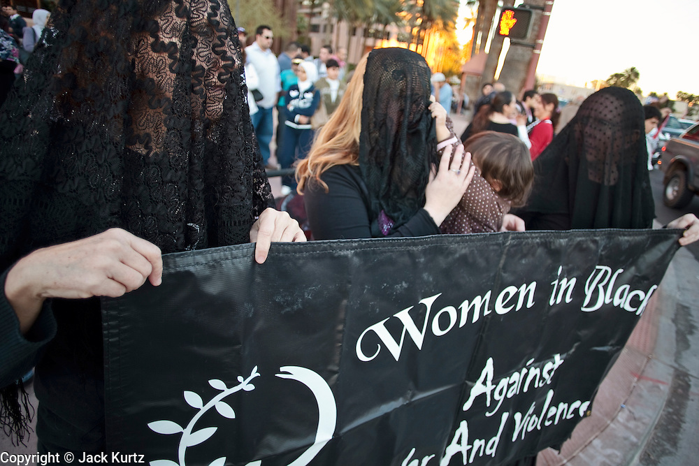 """30 DECEMBER 2008 -- PHOENIX, AZ: Members of """"Women in Black"""" in Phoenix, AZ, conduct a vigil in opposition to Israeli attacks on Gaza, Tuesday. About 200 people from a variety of human rights and peace activists organizations in Phoenix, AZ, marched in opposition to the Israeli attacks on Gaza and in favor of Palestinian rights on Tuesday, the fourth day of Israeli air strikes on Hamas facilities in Gaza. Photo by Jack Kurtz / ZUMA Press"""