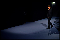 The chancellor of the Exchequer George Osborne makes a call in the Conference Hall at the  Conservative Party Conference in Manchester, Sunday October 2, 2011. Photo By Andrew Parsons / i-Images.