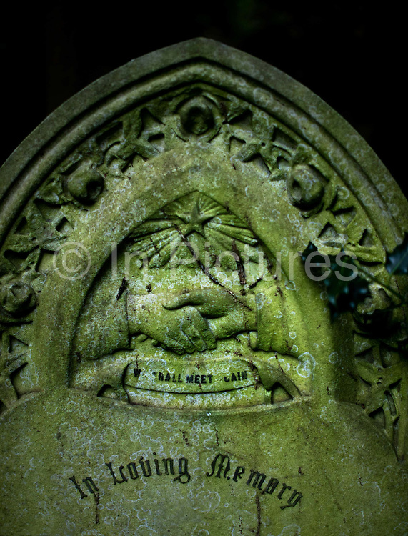 Hands being held beneath a star an a gravestone in Stoke Newington Abney Park Cemetry, London UK. Abney Park cemetery is one of the Magnificent Seven cemeteries in London, England. <br /> By the early 1990s the cemetery was acknowledged to be the largest woodland ecosystem in North London, close to the centre of the City of London.