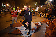 Boston, MA 12/09/2011.Boston Police Superintendent William Evans carries an Occupy Boston tent out of Atlantic Avenue early Friday morning..Alex Jones / www.alexjonesphoto.com